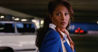 Cabo Air stewardess Jackie Brown (Pam Grier) is stopped by law officers in an LAX parking lot.