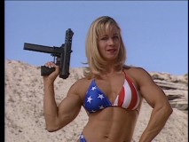 "In ""Chicks Who Love Guns"", this muscular patriot puts on a gun show in more ways than one."