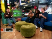 Carson Daly talks with Bridget Fonda, Pam Grier, and Quentin Tarantino on an MTV Live set festively decorated for Christmas 1997.