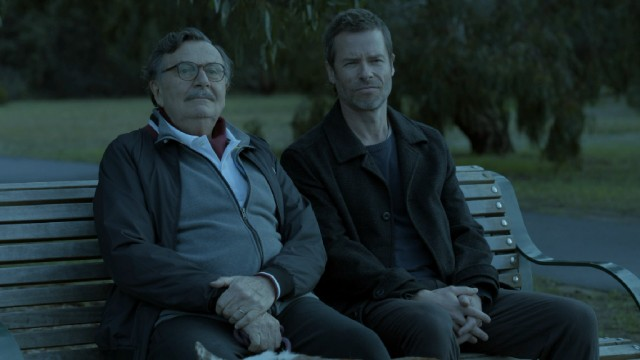 "Jack Irish (Guy Pearce) and his former father-in-law Justice Colin Loder (Barry Humphries) meet at a bench overlooking hot air balloon takeoffs in ""Jack Irish: Dead Point."""