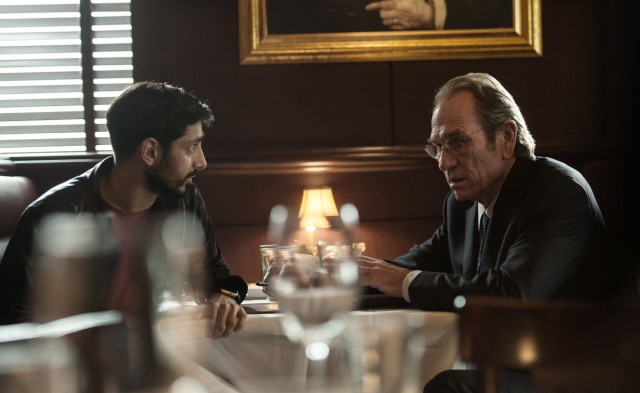 CIA Director Robert Dewey (Tommy Lee Jones) collaborates with tech entrepreneur Aaron Kalloor (Riz Ahmed) on a privacy-invading program.