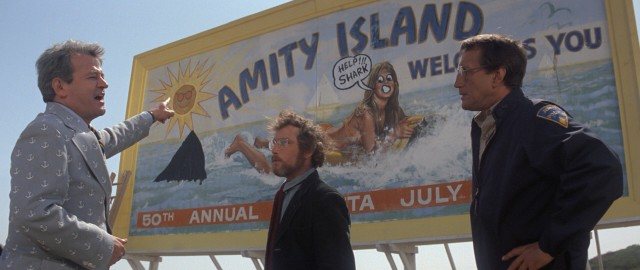 Amity Island's Mayor Larry Vaughn (Murray Hamilton) is more troubled by billboard vandalism than the shark problem it calls attention to.