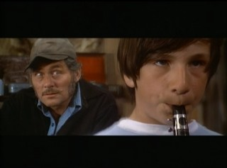 "Quint (Robert Shaw) adds to a young flute-playing shopper's performance of ""Ode to Joy"" in this standout deleted scene."