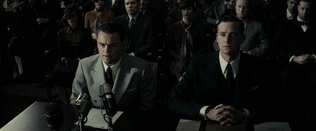 A young J. Edgar Hoover (Leonardo DiCaprio) testifies before Congress next to his right hand man Clyde Tolson (Armie Hammer).