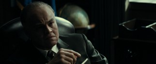 An older, fatter J. Edgar Hoover (Leonardo DiCaprio made-up) recounts his life experiences to young biographers.