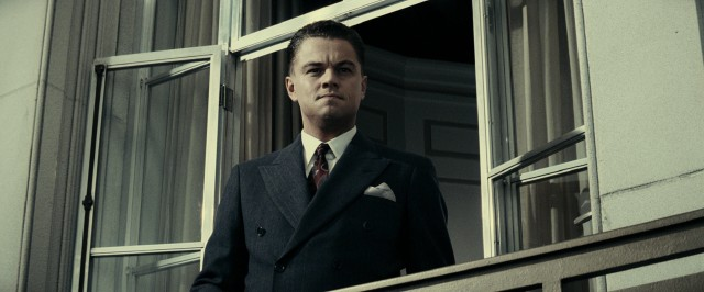 J. Edgar Hoover (Leonardo DiCaprio) steps out on his office balcony to see a presidential motorcade below.