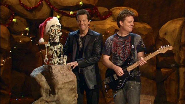 "Achmed the Dead Terrorist and Jeff Dunham have ""guitar guy"" Brian Haner fighting laughter during ""Jeff Dunham's Very Special Christmas Special."""