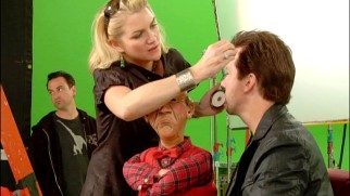 Walter gets between a make-up artist and Jeff Dunham during the filming of their green screen sleigh ride cold open.