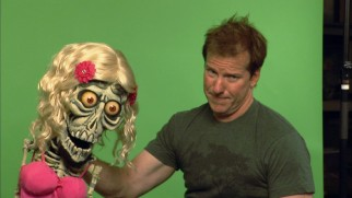Jeff Dunham is photographed with Achmed in the American woman costume he wears in the special.