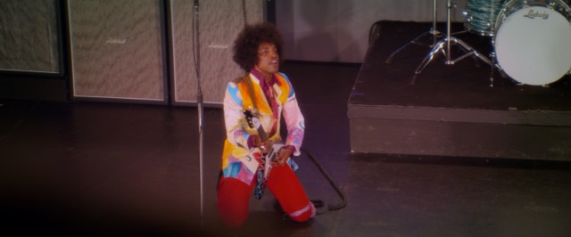 "In ""Jimi: All Is By My Side"", Jimi Hendrix (André Benjamin) gets down in a colorful ensemble to cover The Beatles for a crowd that includes The Beatles."