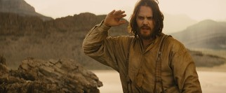 Haggard Civil War veteran John Carter (Taylor Kitsch) surrenders to the tall, four-armed green aliens who outnumber him on Barsoom.