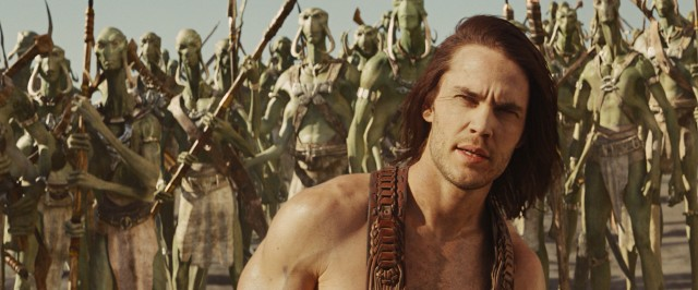 On Barsoom (Mars), John Carter (Taylor Kitsch) is a lone man among hordes of green Tharks.