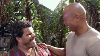 Luis Guzm�n and Dwayne Johnson share a laugh in an unused bit seen in the gag reel.