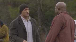 This deleted scene reveals that Hank (Dwayne Johnson) is in construction and wears the occasional wool cap.