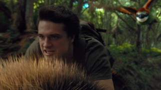 "Riding on the back of a giant bee, Sean (Josh Hutcherson) tries to evade an even bigger bird in ""Journey 2: The Mysterious Island."""