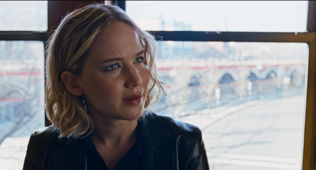 Joy (Jennifer Lawrence) cuts her hair and gets down to business in the film's Dallas-set climax.