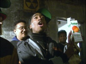 "Tupac Shakur lets the cast and crew know that he is drinking juice and only juice (Tropicana orange juice, specifically) straight out of the carton in this footage from production seen in ""The Wrecking Crew."""