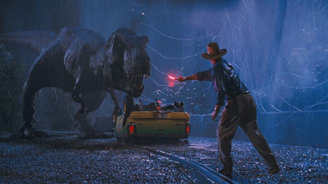 Dr. Alan Grant knows how to disarm a Tyrannosaurus Rex. Ian Malcolm, not so much.