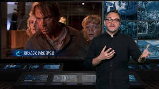 "Director Colin Trevorrow talks about modeling certain aspects after the classic original 1993 ""Jurassic Park"", shown beside him."
