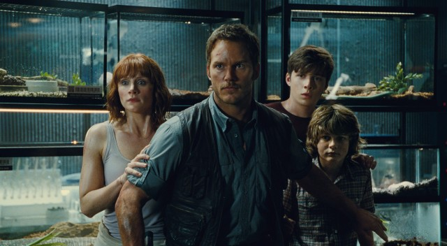 "Claire (Bryce Dallas Howard), Owen (Chris Pratt), Zach (Nick Robinson), and Gray (Ty Simpkins) brace themselves in the midst of some dinosaur danger in ""Jurassic World."""