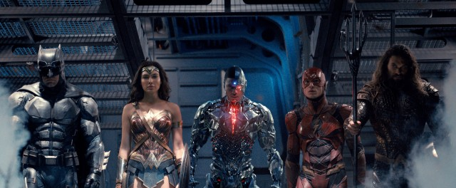 "Batman (Ben Affleck), Wonder Woman (Gal Gadot), Cyborg (Ray Fisher), The Flash (Ezra Miller), and Aquaman (Jason Momoa) form the Justice League in ""Justice League."""