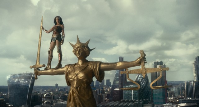 Wonder Woman stands tall on the arm of...Justice.