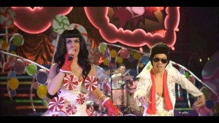 "Katy Perry gets held from a dancing Asian Elvis in her full concert performance of ""Waking Up in Vegas."""