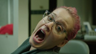 A pink-haired, bespectacled Katy Perry reacts to getting an ankle tattoo commemorating the California Dreams Tour.