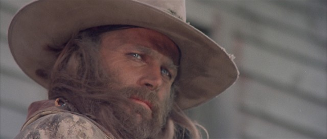 With long, flowing hair and a bushy beard, Franco Nero holds the iconic title role of Keoma.