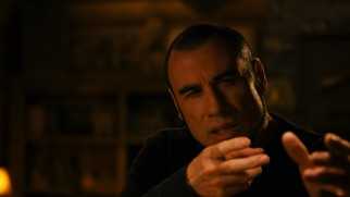 "Sporting a chin curtain and a Serbian accent, John Travolta gets his hands in ""Phenomenon"" position."