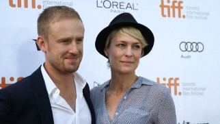 Hollywood's new It Couple, Ben Foster and Robin Wright Penn, smiles for the cameras on the red carpet at the Toronto Film Festival.