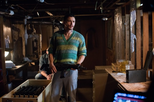As the villain Taylor Balik, James Franco sports a bad hairdo, ill-fitting sweaters, and neck tatoos.