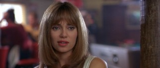 Claudia (Vanessa Angel) becomes the third member of their party, using her looks to help their bowling alley hustle.