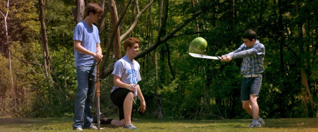 "In ""The Kings of Summer"", three teenage boys spend summer vacation in the woods, entertaining themselves with stunts like slicing an airborne watermelon with a sword."