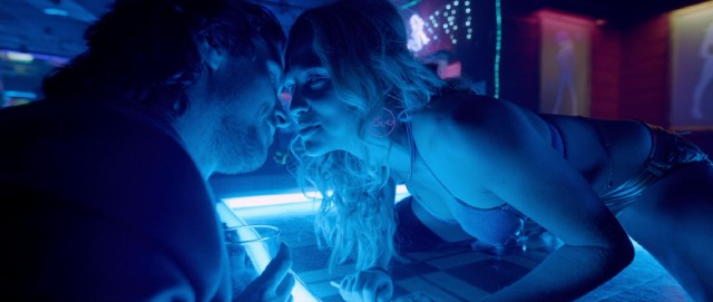 Terrence Malick briefly opts for a Nicholas Winding Refn aesthetic, as Rick (Christian Bale) takes a liking to Karen (Teresa Palmer), a free-spirited stripper from Australia.