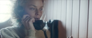 Liv (Agnes Kittelsen) gets a call from her husband as he begins to start his improbable mission from Peru to Polynesia.