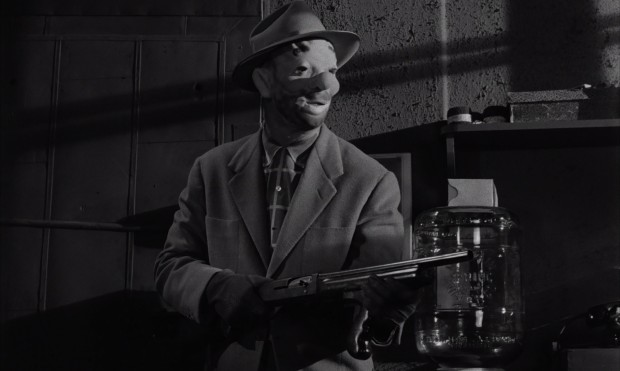"Despite the clown mask, Johnny Clay (Sterling Hayden) is not at the race track to entertain, but to steal $2 million in Stanley Kubrick's ""The Killing."""