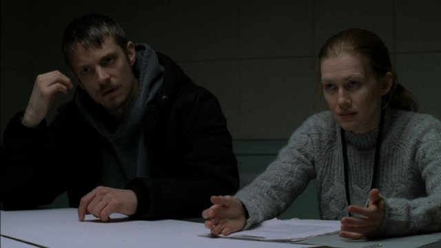 "Stephen Holder (Joel Kinnaman) and Sarah Linden (Mireille Enos) are unlikely partners on a puzzling homicide investigation in the AMC drama ""The Killing."""