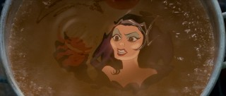 "The latest in a long line of animated Disney villains is ""Enchanted"" antagonist Queen Narissa, who here appears with a poisoned apple in a live-action boiling pot."