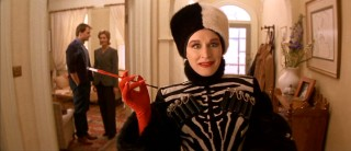 Glenn Close revels in the part of flashy villainess Cruella DeVil, here excited to hear that puppies are on the way.