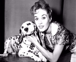 Voice actress Lisa Davis poses with a dalmatian in this still from the 101 Dalmatians: Platinum Edition DVD's production photos gallery.