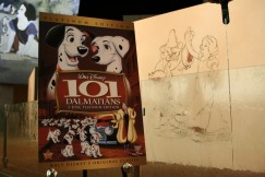 "Artwork from Walt Disney's first animated feature, ""Snow White and the Seven Dwarfs"", surrounds a poster of the DVD cover art that's the reason for the junket."