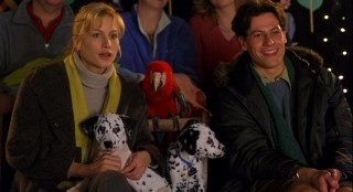 Wearing their emotions of skeptical and pleased, Chloe (Alice Evans) and Kevin (Ioan Gruffudd) take in a Punch and Judy show with the dogs. Yes, that includes parrot, er, rottweiler Waddlesworth.