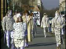 "Londoners dressed in spotted fur are seen in behind-the-scenes featurette ""Designing Dalmatians."""