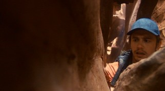 Sixteen minutes into the film, solo canyoneer Aron Ralston (James Franco) finds himself stuck between a rock and hard place.