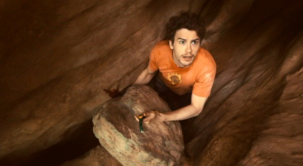 "Aron Ralston (James Franco) looks and shouts up for help, to no avail, in Danny Boyle's Academy Award-nominated true-life survival drama ""127 Hours."""