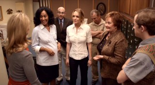 Thea Clayhill (Lindsay Lohan) becomes the center of attention around her office after she shares the not-so-true news she's pregnant.