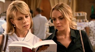 Lisa (Cheryl Hines) and Thea (Lindsay Lohan) learn a few things about pregnancy on the maternity store's checkout line.