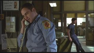 Jack takes a phone call at the firehouse while being heckled by his coworkers.