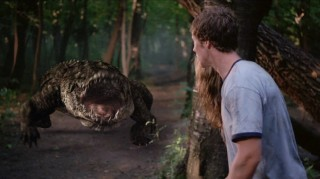 Scott Riley (Chad Collins) stands still, thinking the croc's vision is based on movement like the T-Rex.